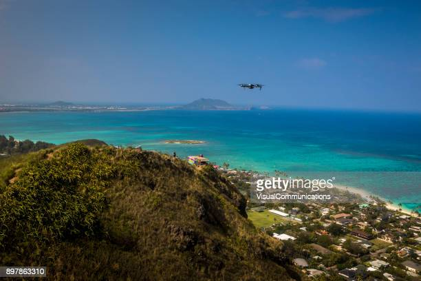 Drone flying over hills close to Lanikai white sand beach.