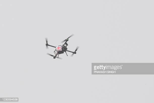 Drone from the army offensive swarm drone system fly carries first-aid box to demonstrate skills during a ceremony to celebrate India's 73rd Army Day...