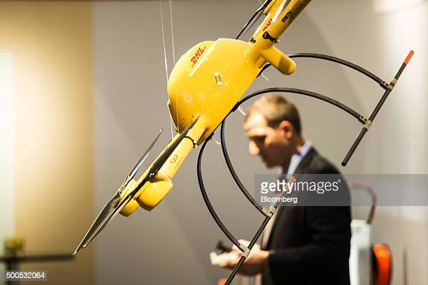 A drone hangs on display at the launch of the Asia Pacific Innovation Center operated by DHL a unit of Deutsche Post AG in Singapore on Wednesday Dec...