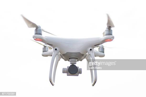 Drone hovering against white background