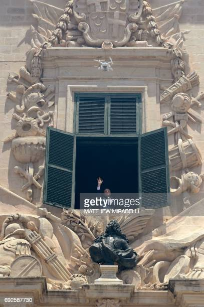 A drone hovers as Joseph Muscat gestures towards his supporters after his swearing in ceremony as Prime Minister of Malta at The Palace of the Grand...