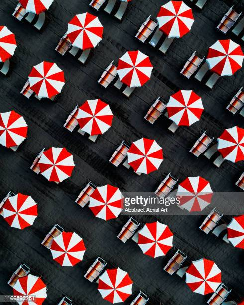 drone image directly above beach umbrellas, massa, italy - parasol stock pictures, royalty-free photos & images