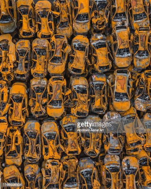 drone image of cars damaged by fire, savona, italy - rust colored fotografías e imágenes de stock