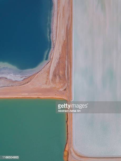 drone image of salt storage ponds, western australia - ソルトポンド ストックフォトと画像