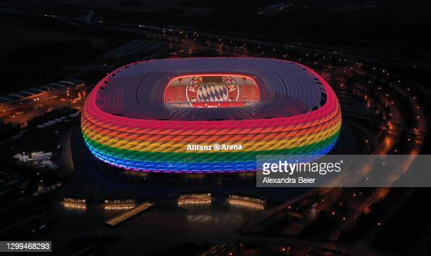 Drone image shows the Allianz Arena soccer stadium illuminated in rainbow colours during the Bundesliga match between FC Bayern Muenchen and TSG...