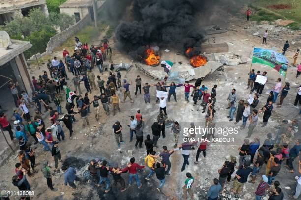 TOPSHOT A drone images shows Syrian demonstrators gathering during a protest in the village of Maaret alNaasan in Syria's Idlib province on May 1 to...
