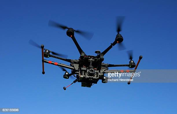 drone in flight - drone stock pictures, royalty-free photos & images