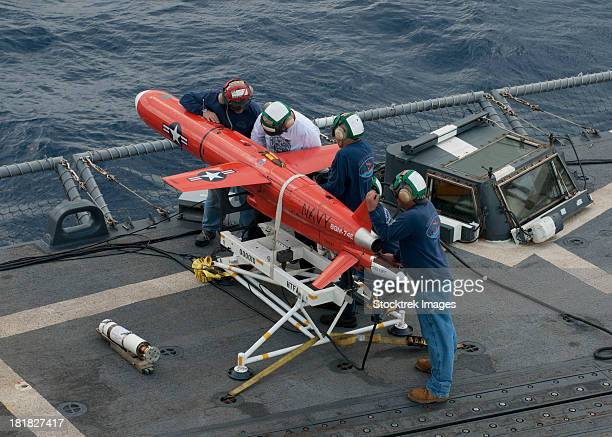 a bqm-74e drone is prepared for launch from the flight deck of uss underwood. - military drones stock photos and pictures