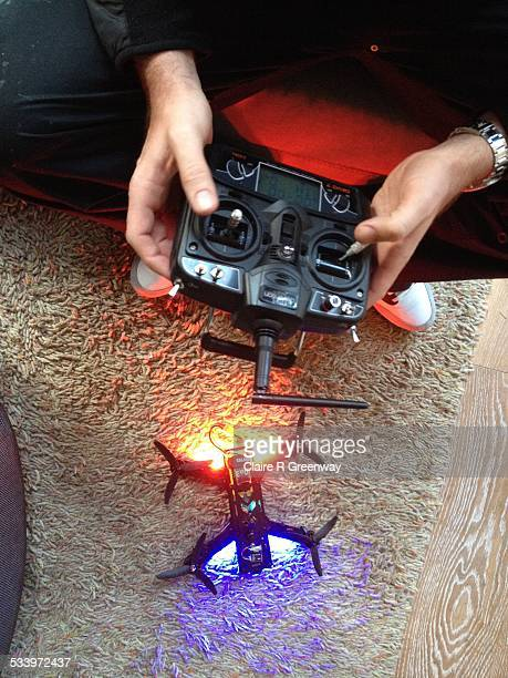 A drone is readied for take off indoors of a London apartment