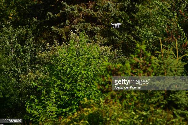 Drone, operated by police forces, flies by an allotment as police continue to search the area in relation to the disappearance of Madeleine McCann on...
