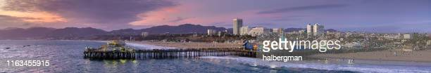 drone panorama of santa monica at sunset - santa monica stock pictures, royalty-free photos & images