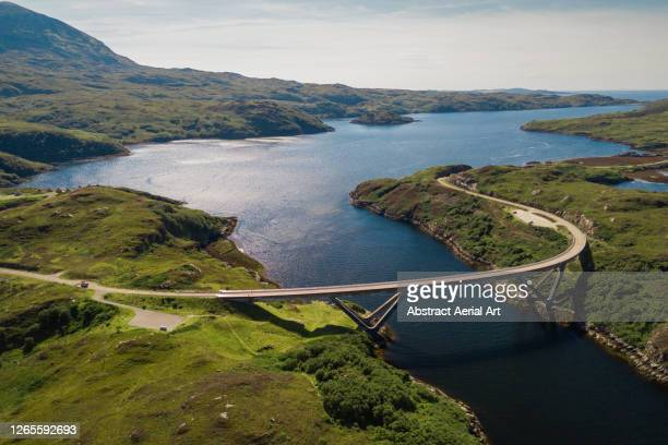 drone perspective of kylesku bridge, scotland, united kingdom - awe stock pictures, royalty-free photos & images