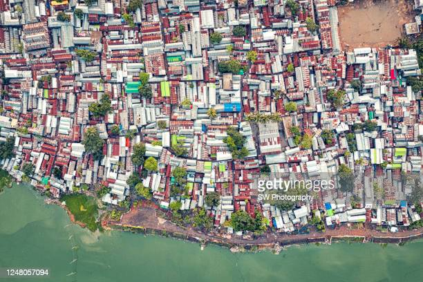 drone photo of a crowed residential district in dhaka, bangladesh - bangladesh stock pictures, royalty-free photos & images