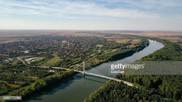 Drone photo of bridge crossing Tisa river in bio-industrial area