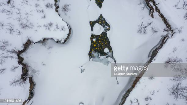 drone photo of canyon with frozen river on a cloudy day in abisko sweden northern hemisphere - norrbotten province stock pictures, royalty-free photos & images