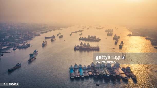 drone photo of cargo ships at chittagong port, chittagong, bangladesh - チッタゴン ストックフォトと画像