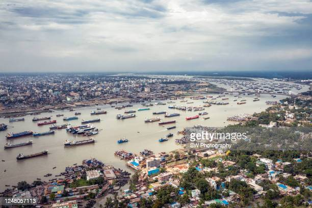 drone photo of cargo ships at chittagong port, chittagong, bangladesh - bangladesh stock-fotos und bilder