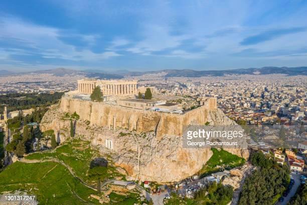 drone photo of the acropolis of athens, greece - パルテノン神殿 ストックフォトと画像