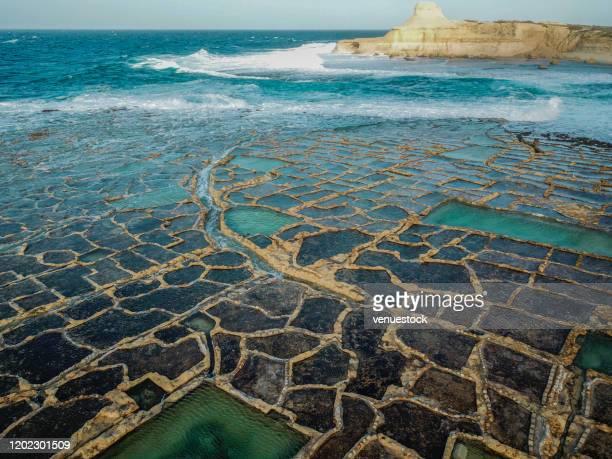 drone photo - salt pans of gozo, malta stock photo - malta fotografías e imágenes de stock