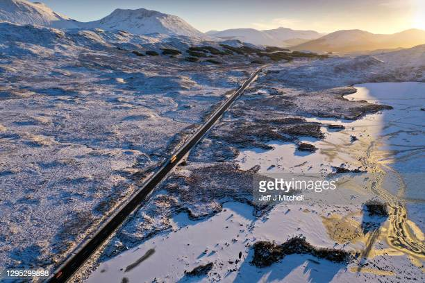 Drone photo shows a bus bound for Glasgow passing a frozen Lochan na Achlaise as freexing temperatures continue on January 8, 2021 in Glen Coe,...