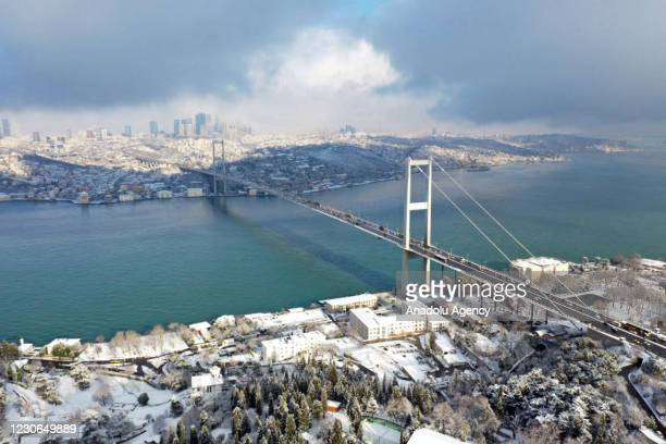 Drone photo shows a view of July 15 Martyrs Bridge during a snowfall in Istanbul, Turkey on January 18, 2021.