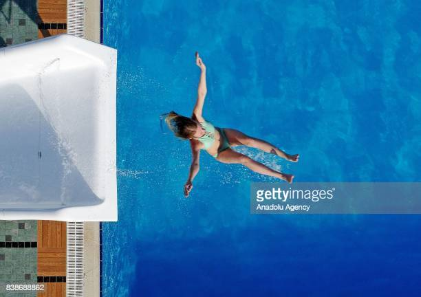 Drone photo shows a woman jumping into the swimming pool at a water park in Kusadasi district in Aydin province of Turkey on August 24 2017