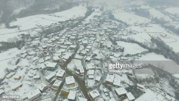 A drone photo shows an aerial view of a village in Demirkoy district after a snowfall in Kirklareli Turkey on January 15 2018