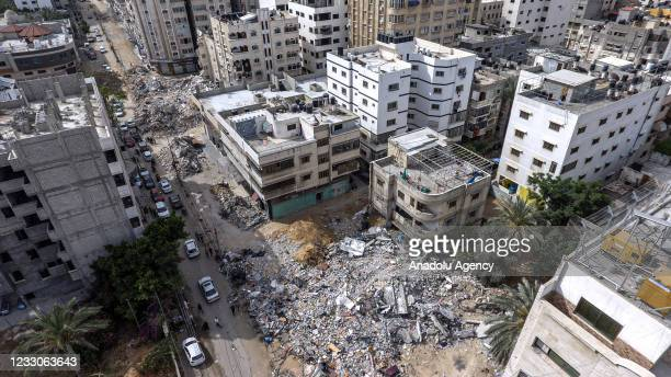 Drone photo shows an aerial view of destroyed residental buildings in Rimal neighborhood in Gaza City aftermath of 11 days of Israeli airstrikes on...