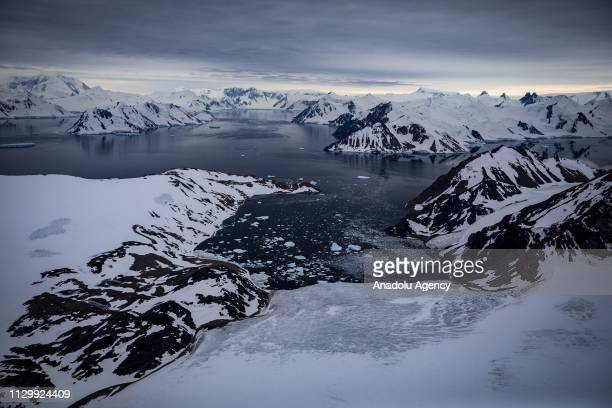 A drone photo shows an aerial view of glaciers and snow covered mountains in Antarctica on February 22 2019 Turkish scientific research team has just...
