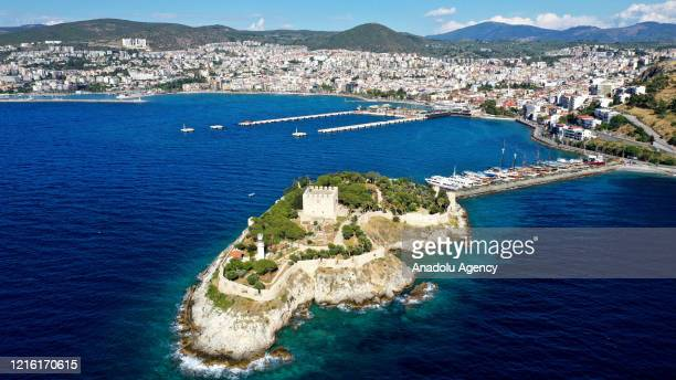 A drone photo shows an aerial view of Guvercinada Castle on May 29 2020 at Kusadasi district in Aydin Turkey Guvercinada Castle added to the UNESCO...