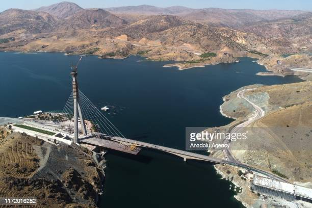 Drone photo shows an aerial view of Komurhan Cable-Stayed Bridge which is being built on Karakaya Dam reservoir, across the Euphrates River in Elazig...