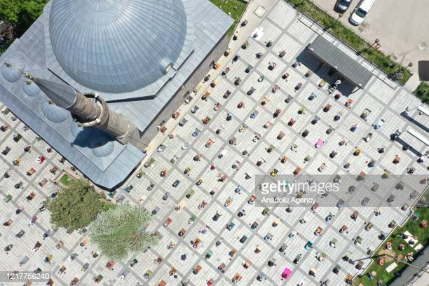 A drone photo shows an aerial view of Muslims performing Friday prayer at Erzurum Yakutiye City Square while keeping social distance and wearing...