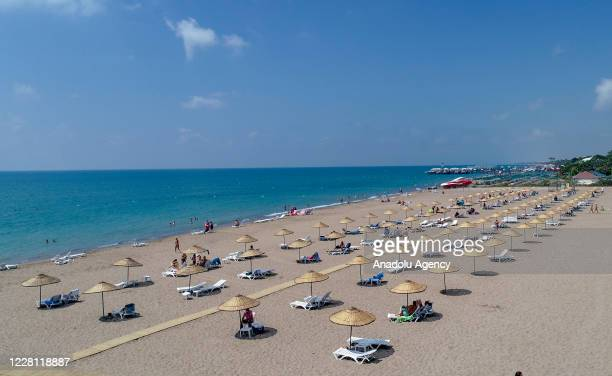 Drone photo shows an aerial view of people enjoying the sun at public beaches in Belek and Kadriye resorts in Antalya province of Turkey on August...