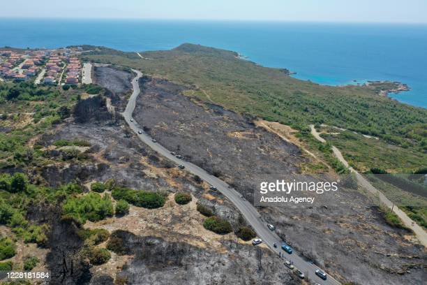 A drone photo shows burnt grassland areas after a fire broke out near Ekmeksiz Beach in Sigacik neighbourhood in Seferihisar district of Turkey's...