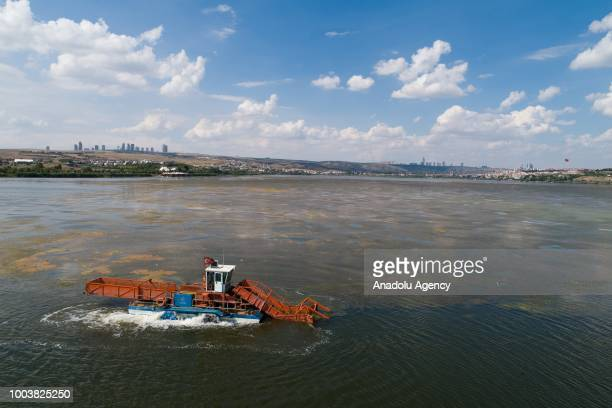 A drone photo shows Lake Mogan during its bottom mud cleaning works planned to be finished until the end of the year in Ankara Turkey on July 19 2018...