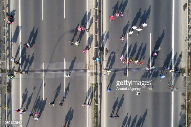 A drone photo shows participants passing over Istanbuls July 15 Martyrs Bridge as they compete in the World's only intercontinental marathon...