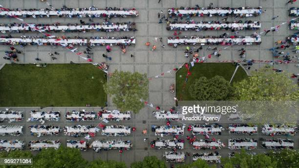 A drone photo shows people attending iftar dinner organised by Fatih Municipality at Sultanahmet Square on the first day of holy month of Ramadan in...