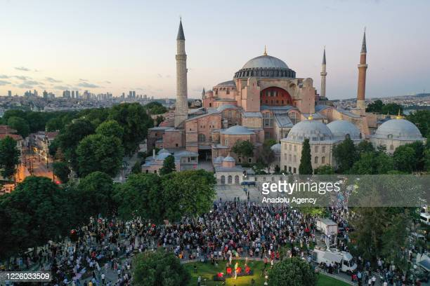 A drone photo shows people gathered to perform the evening prayer at Ayasofya Square after the 10th Chamber of the Council of State's decision of the...