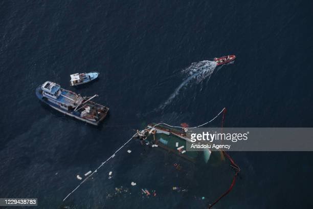Drone photo shows remove works for the sinking boat continue after a boat capsized in the Mediterranean Sea off southern Turkey, Antalya on November...