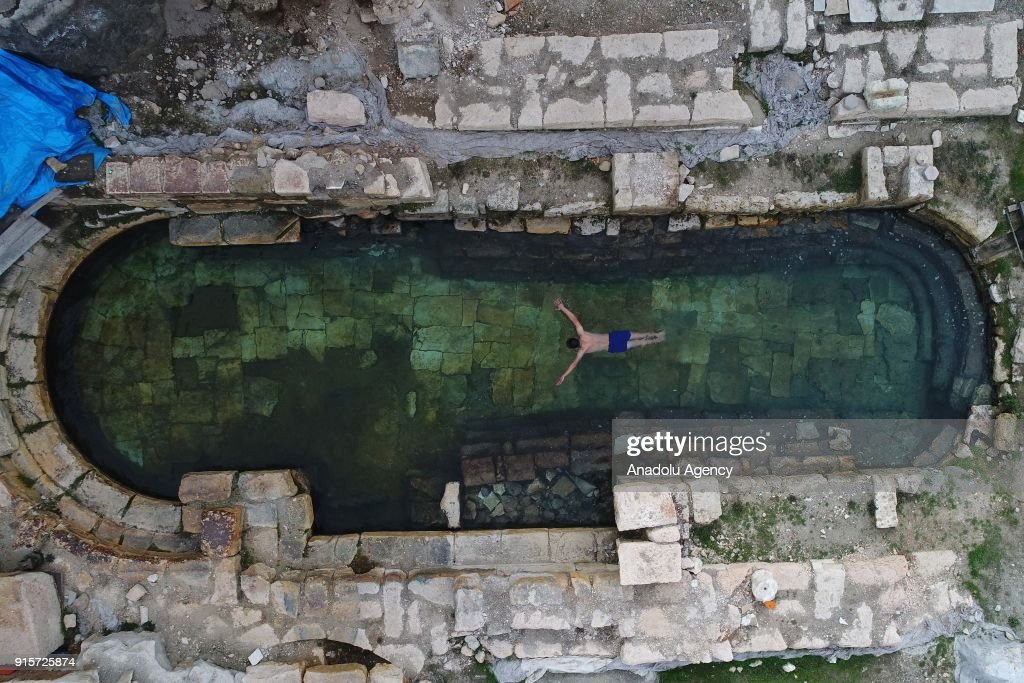 A drone photo shows the aerial view of 2,000-year old ancient Roman Bath Basilica Therma at Sarikaya district of the central Yozgat province in Turkey on February 08, 2018. With it's 48-49 centigrade degrees water temperature the bath provides an opportunity for swimming during winter season. Basilica Therma, also known as the King's Daughter which is one of the historical figure of the Roman Empire, attracts many tourists' attention.