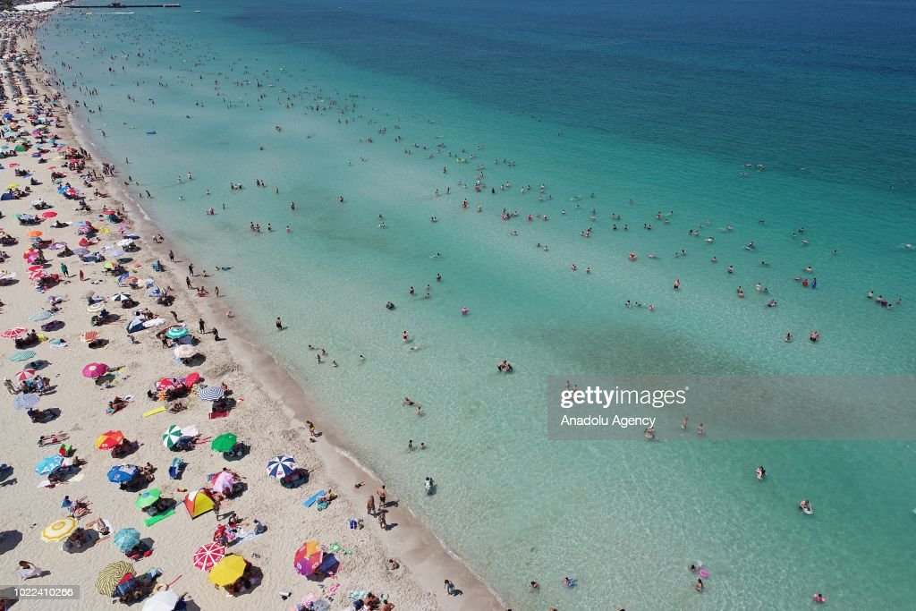 Drone Photo Shows The Aerial View Of People Sunbathing On Ilica Beach And Swimming In