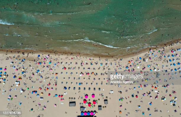 A drone photo shows the crowd sunbathing and swimming at a beach during the third day of Eid AlAdha in Sile district of Istanbul Turkey on August 02...