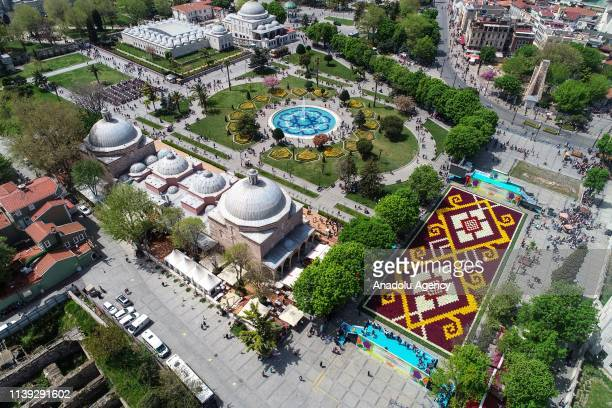 Drone photo shows the world's largest 'Tulip Carpet' at the Sultanahmet Square in Istanbul, Turkey on April 25 2019. The 460 square meters 'Tulip...