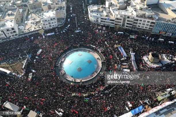 A drone photo shows thousands of Iranians attend the funeral ceremony of Qasem Soleimani commander of Iranian Revolutionary Guards' Quds Forces who...