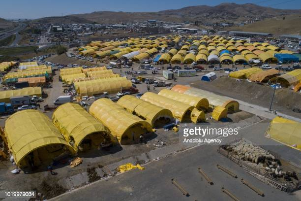 A drone photo shows Yenimahalle Municipality's livestock market on the eve of Eid alAdha in Yenimahalle district of Ankara Turkey on August 20 2018