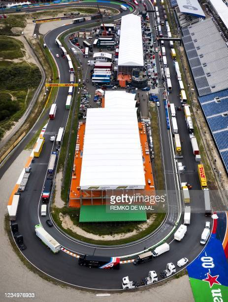 Drone photograph taken on August 31, 2021 shows an aerial view of the different Formula 1 teams building their garages and setting up at the...