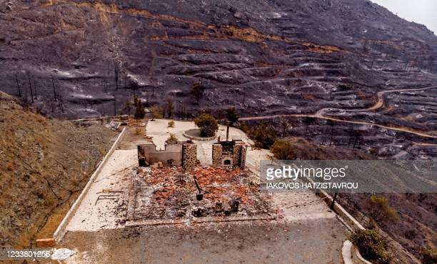 Drone picture taken on July 4, 2021 shows a destroyed house near Ora village on the southern slopes of the Troodos mountains close to Agioi...