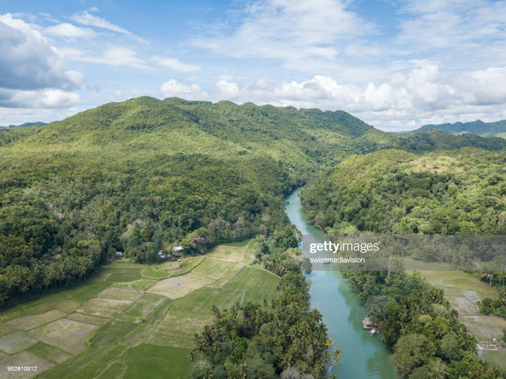 Drone point of view aerial of tropical river in the Philippines palm trees : Stock Photo