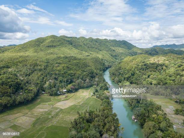 Drone point of view aerial of tropical river in the Philippines palm trees