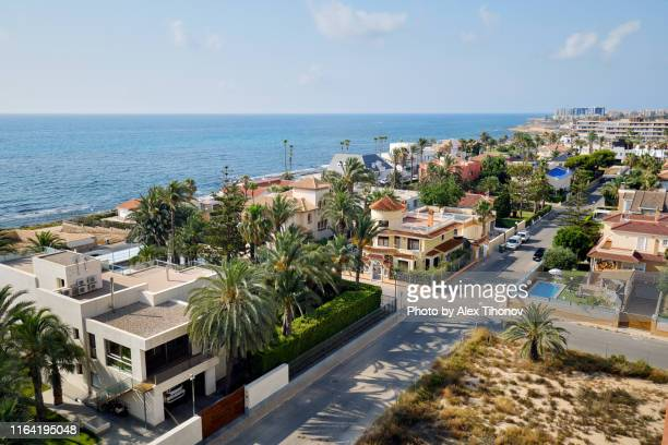 drone point of view la veleta district residential coastal houses spanish resort of torrevieja, sapin - holiday villa stock pictures, royalty-free photos & images